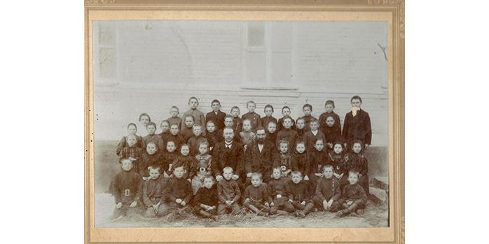 Foto mit Schulklasse und Lehrer Blatz